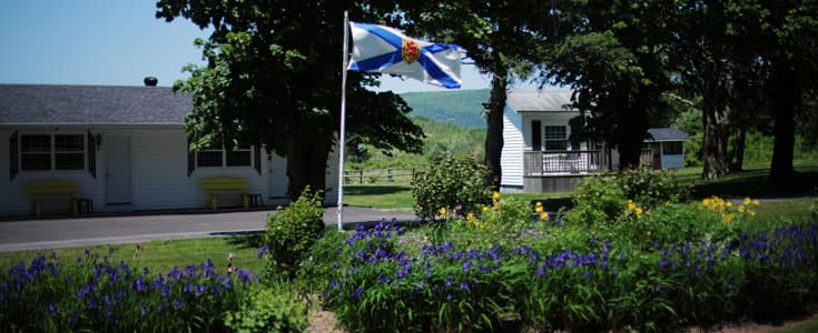 Nova Scotia flag and cabins on the property