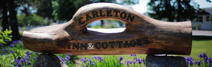 hand carved wooden Carleton Inn and Cabins sign