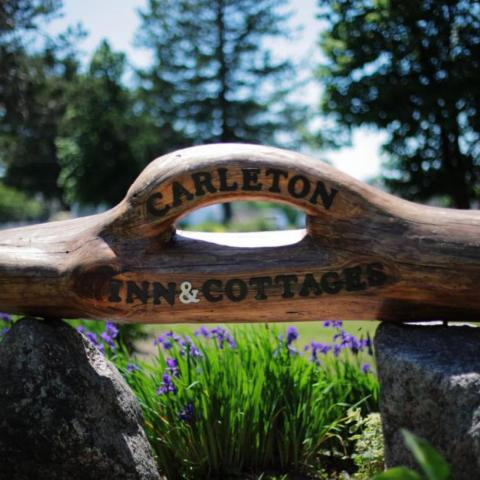 handcarved Carleton Inn and Cottages sign